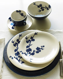 Blue and white ceramic dinnerware with cherry blossom design is ours